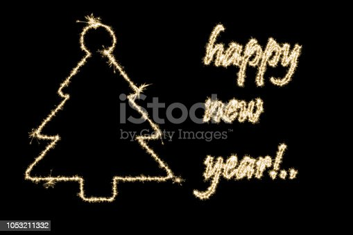 istock christmas tree and happy new year text with sparkle effect 1053211332