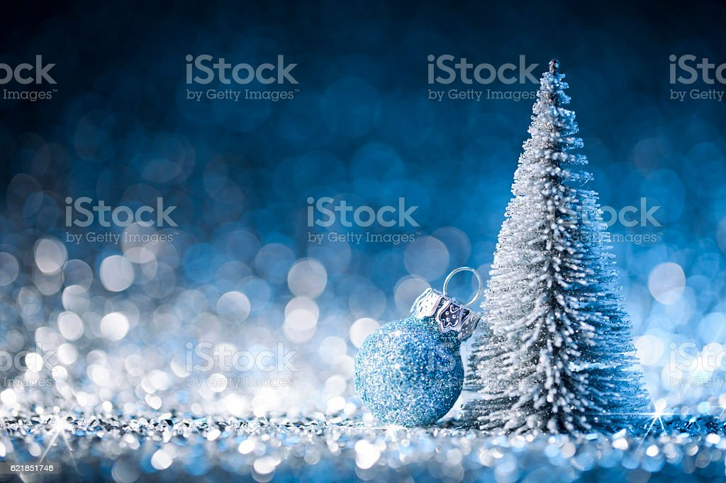 Christmas tree and ornament on defocused lights. Decorations Blue Gold stock photo