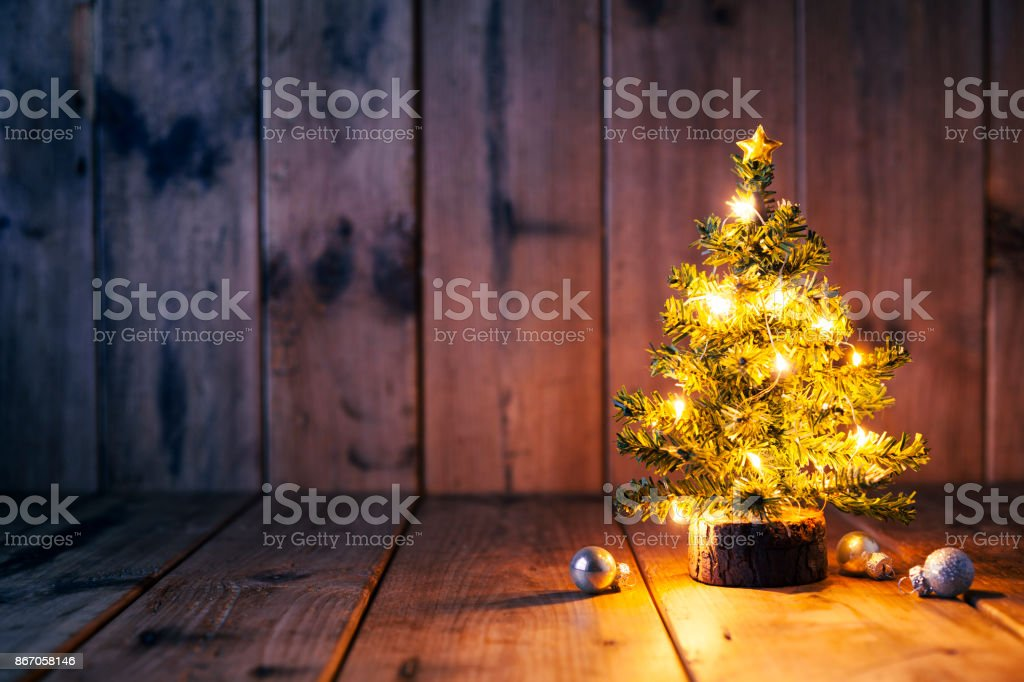 Christmas tree and ornaments on old wood stock photo
