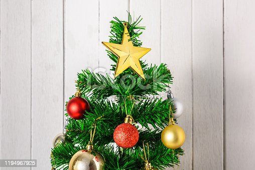 Close up Christmas tree and ornaments with copy space