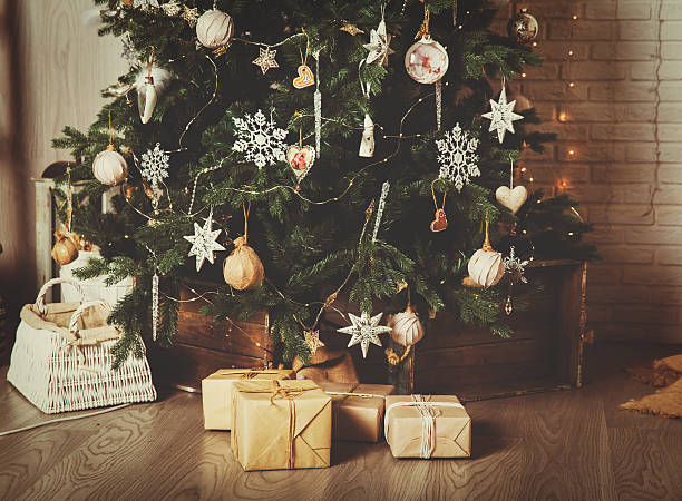christmas tree and presents in decorated living room - christmas tree stock photos and pictures