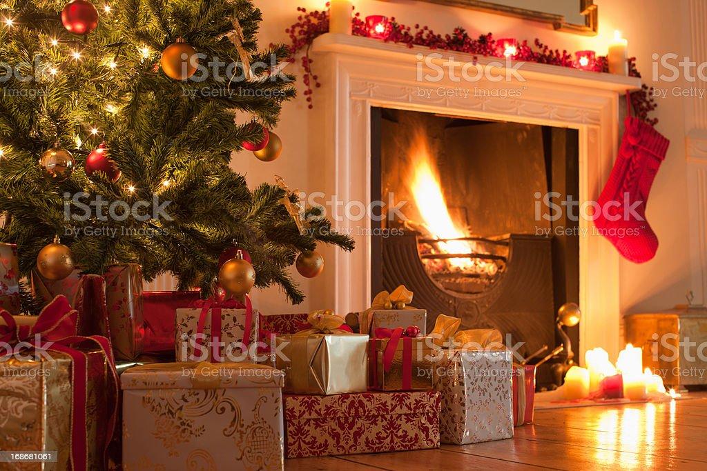 Christmas tree and stocking near fireplace stock photo