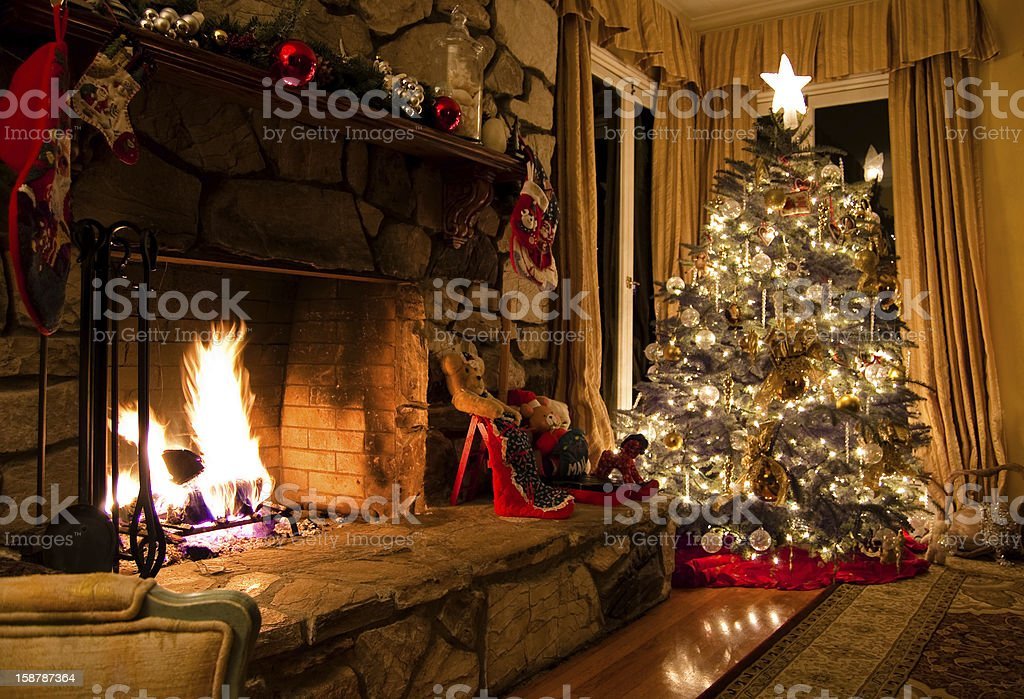 Christmas tree and stone fireplace in a vintage home stock photo