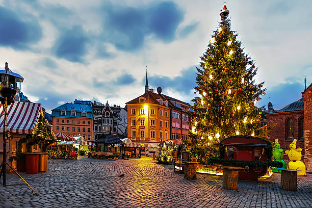 christmas tree and the dome square in the evening - historic vs new stock photos and pictures