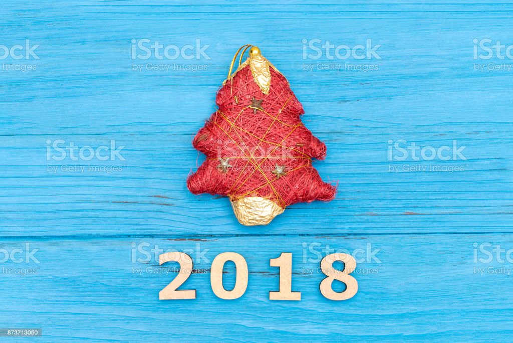 Christmas tree and the numbers 2018 on blue wooden old table stock photo