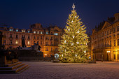 Christmas tree and the Old Town Square in Prague, Czech Republic, covered by fresh snow. No Christmas markets organized in 2020 due to Covid-19