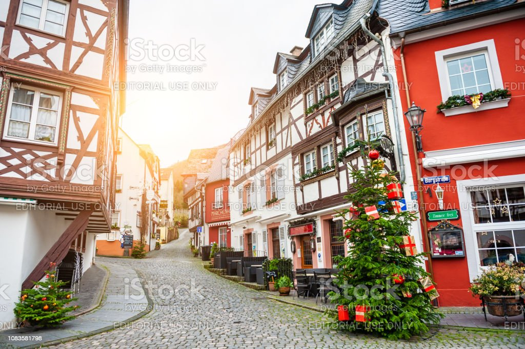Christmas tree and traditional houses on the street in Bernkastel-Kues, Germany stock photo