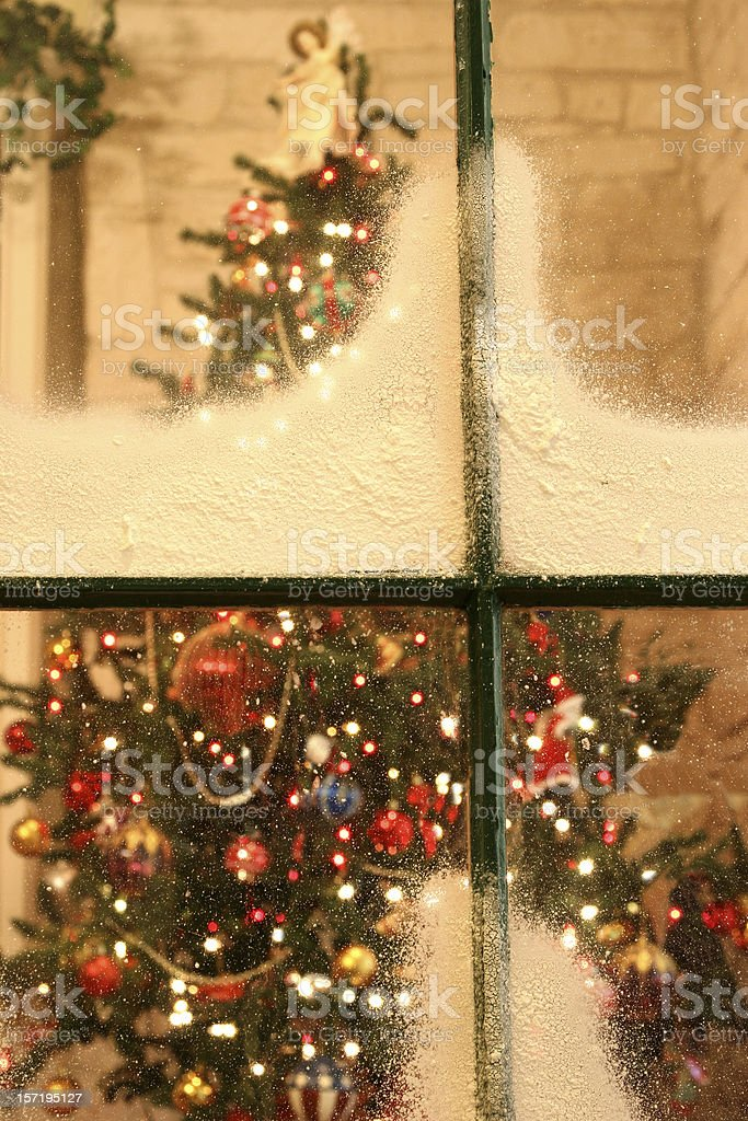 Christmas tree as viewed through a snow covered window. stock photo