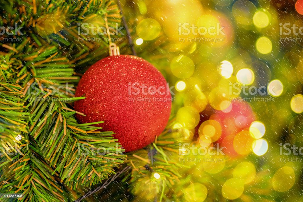 Christmas Tree background over the abstract blurred bokeh, xmas and new year celebration concept stock photo