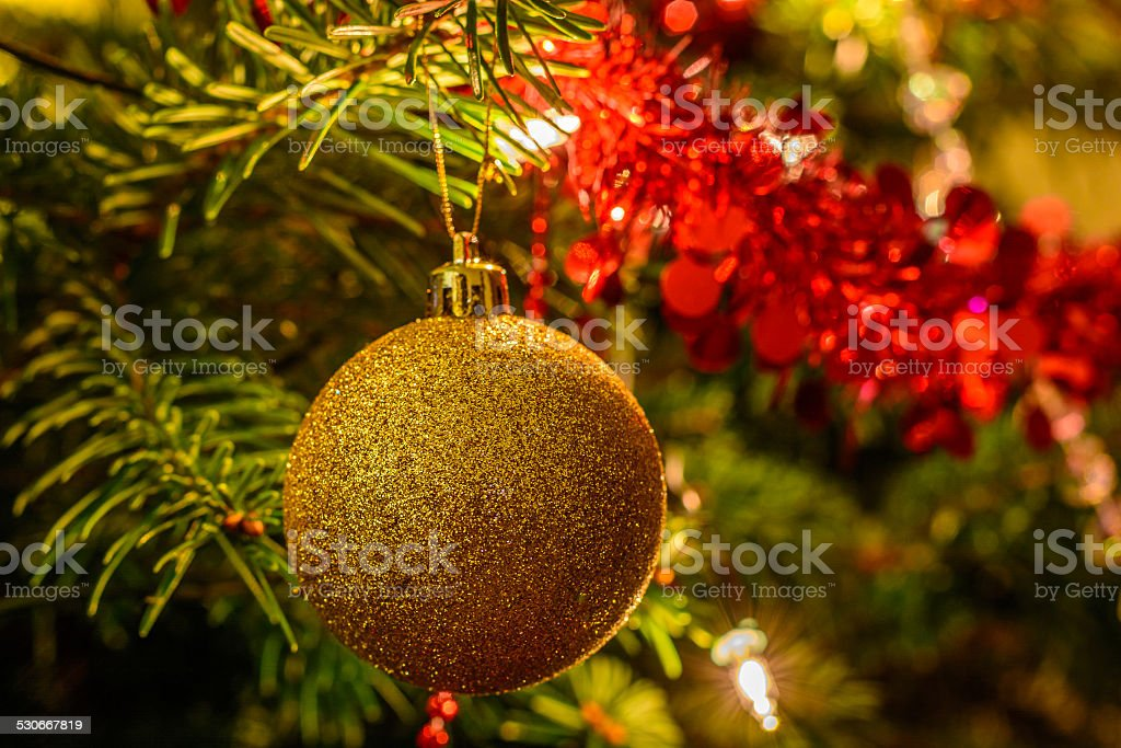 Christmas tree background with Christmas baubles and lights stock photo