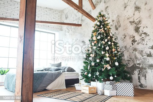 istock Christmas tree background with golden and white decoration 1055157392