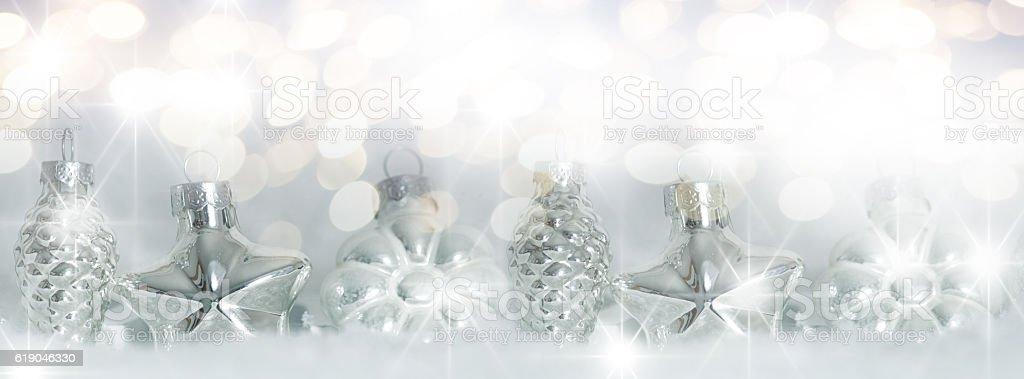 Christmas tree balls in snow stock photo