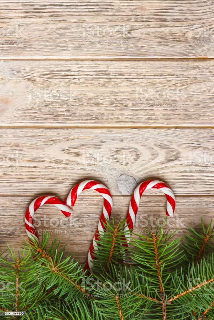 Christmas Tree Branch And Candy Cane On A Wooden Table Or Board For Background New Year Theme Space For Text Stock Photo Download Image Now Istock