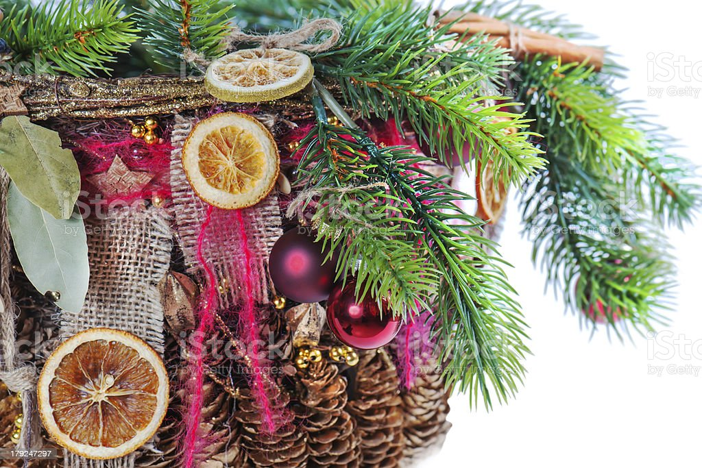 Christmas tree branch decorated with balls, beads, cinnamon. royalty-free stock photo