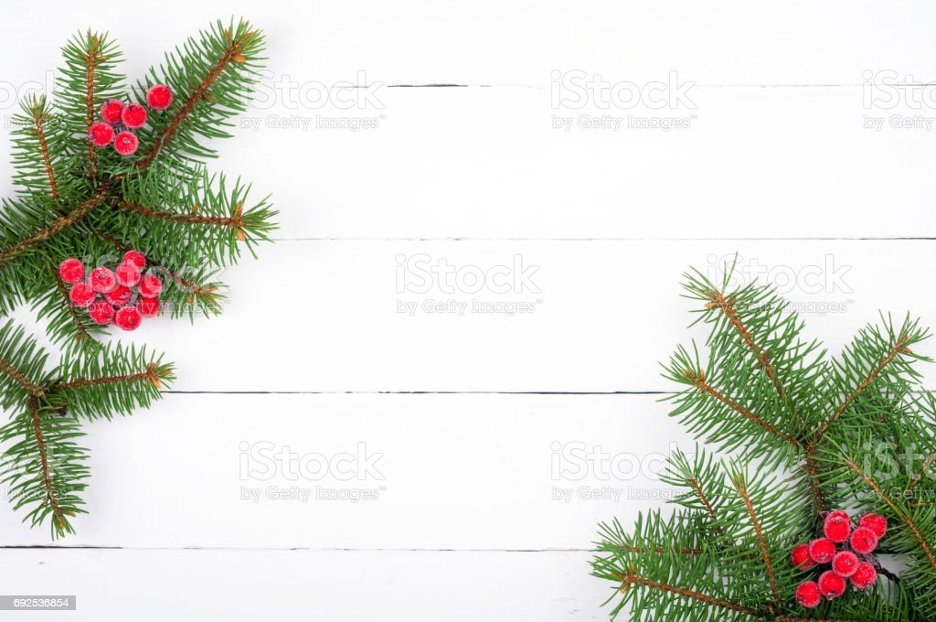 christmas tree branch with decorations on white wooden table christmas background royalty free stock