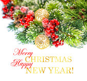 istock christmas tree branch with golden balls 469777383