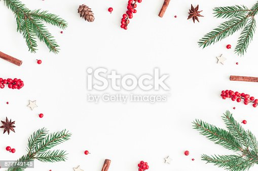 1074095098 istock photo Christmas tree branches and red berries. Flat lay, top view 877749148
