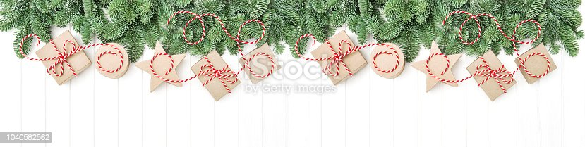 istock Christmas tree branches gift boxes holidays banner 1040582562