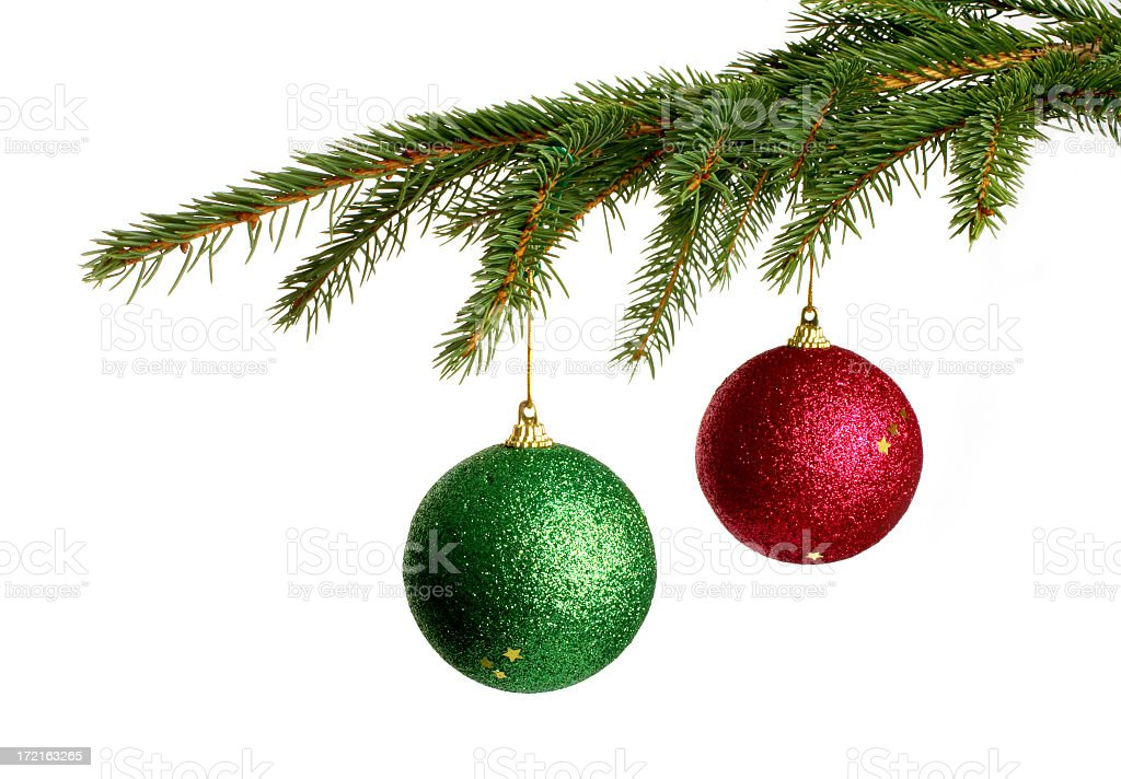 christmas tree branches holding two decorative balls royalty free stock photo - Christmas Tree Branches