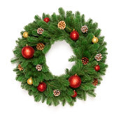 istock Christmas tree branches in a circle frame isolated on white background with copy space for text. Round wreath fir with Christmas toy balls and fir cones. Flat lay 1072381304