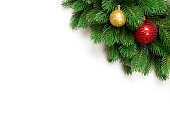 istock Christmas tree branches isolated on white background with copy space for text. Fir with Christmas toy balls and fir cones. Top view 1072381358