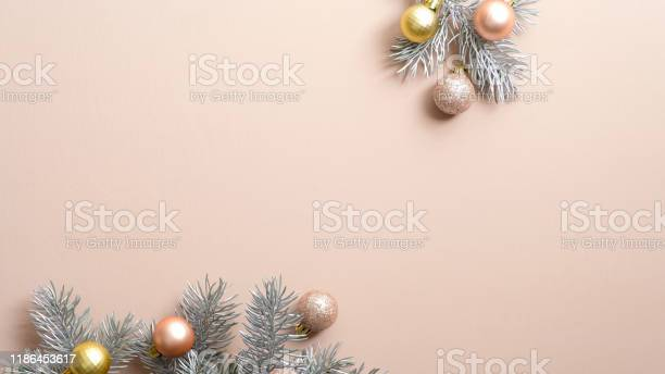 Christmas tree branches with golden silver and pink xmas balls on picture id1186453617?b=1&k=6&m=1186453617&s=612x612&h=ckbpiuwz2ez5dl9b1gw0dqojjhmh39icvcwwaumaibu=