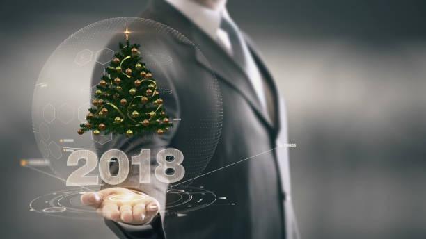 2018 christmas tree businessman holding in hand new technologies - zitate weihnachten stock-fotos und bilder