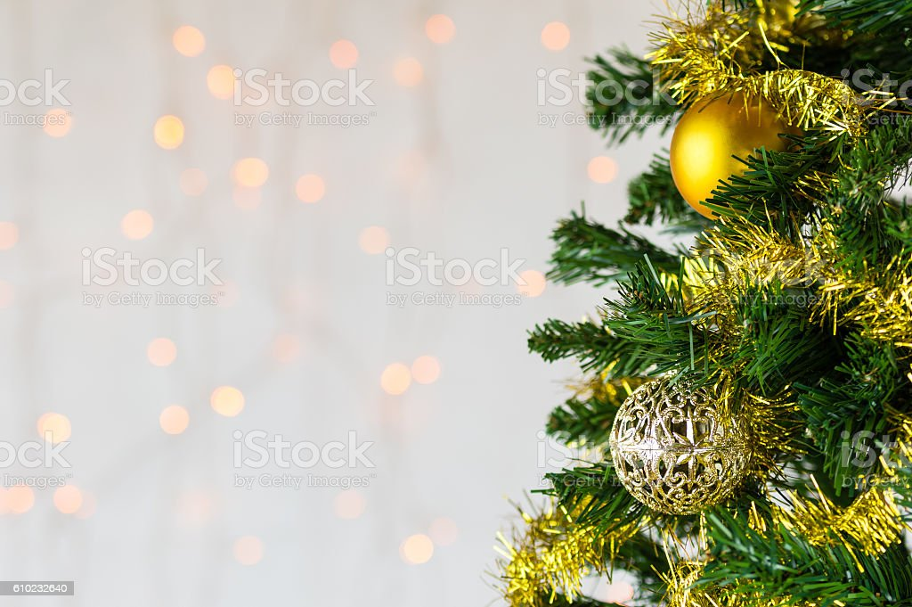 Christmas tree decorated in gold. Close up. stock photo