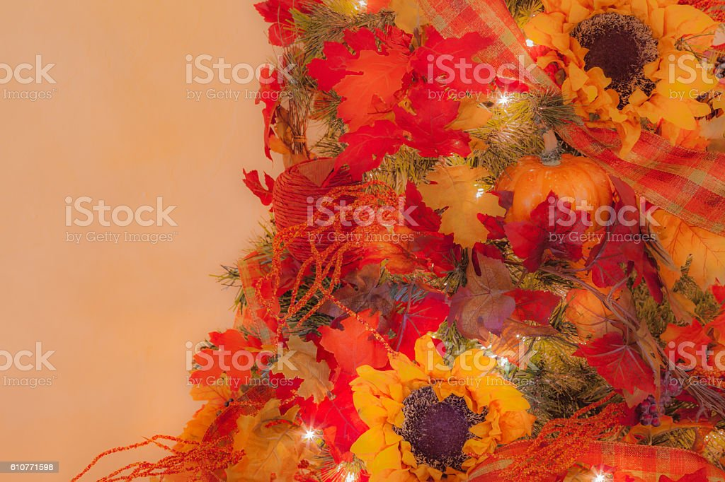Christmas tree decorated in Thanksgiving and Autumn leaves ,Sunflowers (P) stock photo