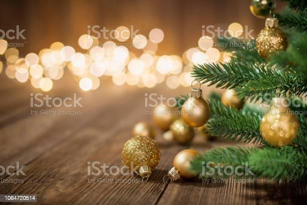 Christmas tree decorated with christmas balls on rustic wood and picture id1064720514?b=1&k=6&m=1064720514&s=612x612&h= qimc3b4jxdtbvcpffzs74537xba8idug7a87adaysy=