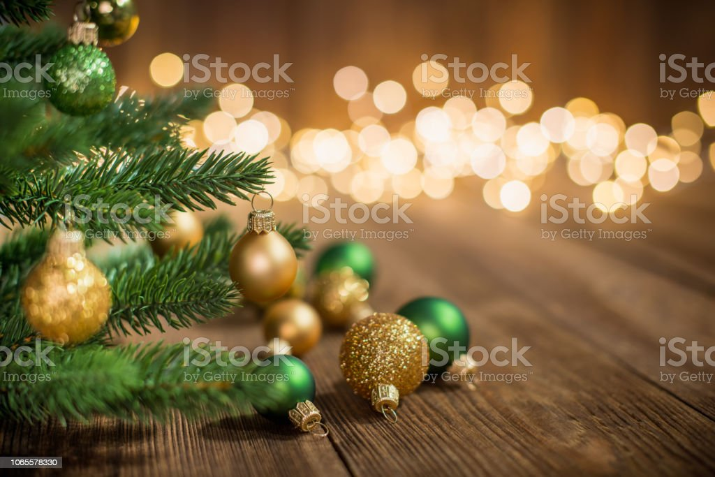 Christmas Tree decorated with christmas balls on rustic wood and sparkles light backgorund stock photo