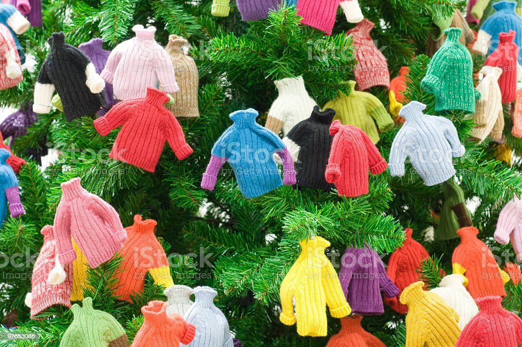 Christmas Tree Decorated With Little Sweaters Stock Photo Download