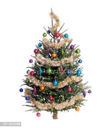 Christmas tree decorated in traditional tinsel and colorful ornaments