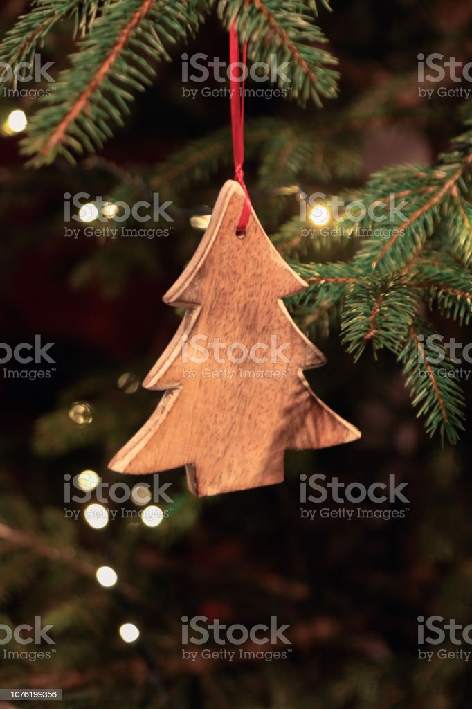 Christmas tree decorated with wooden ornament