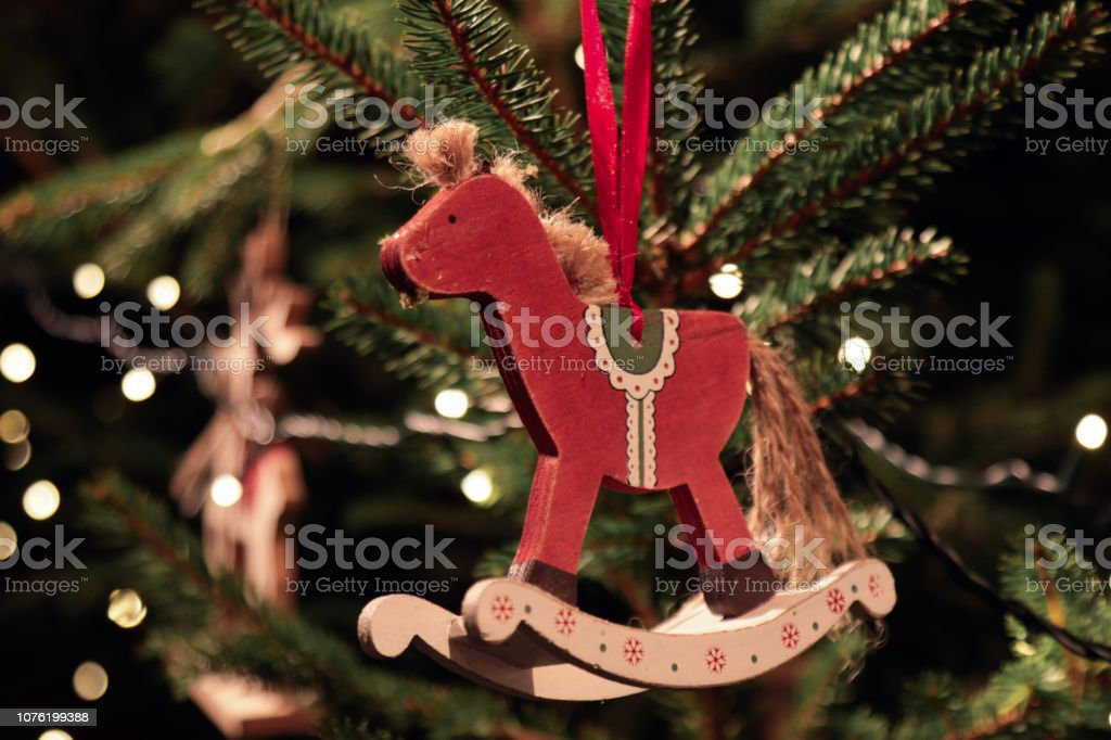 Christmas tree decorated with wooden rocking horse ornament