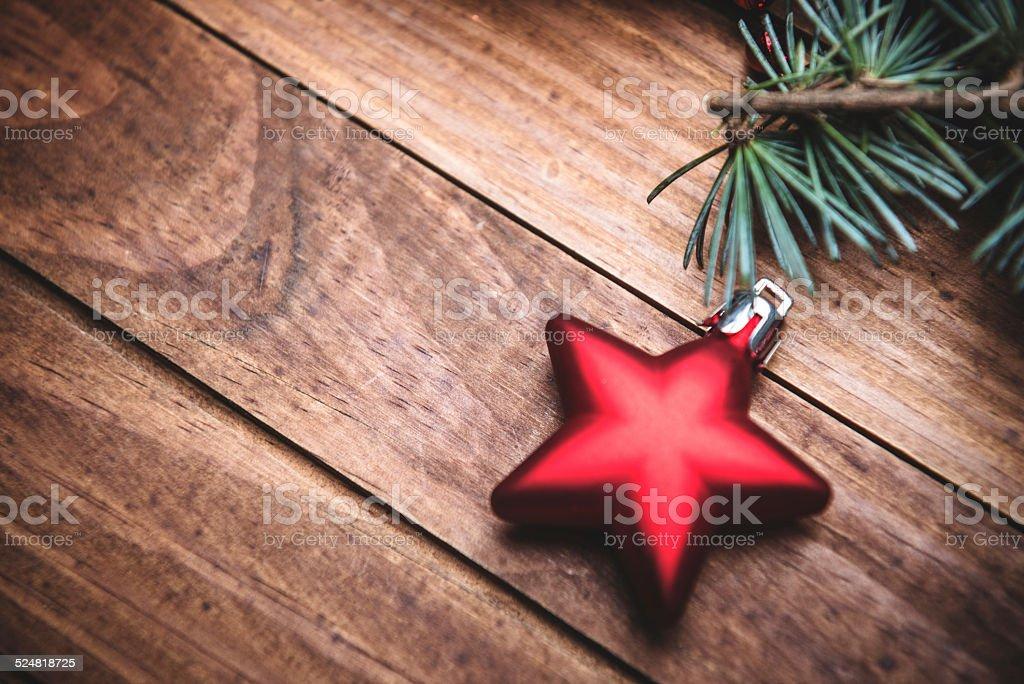 christmas tree decoration on a plank wood stock photo