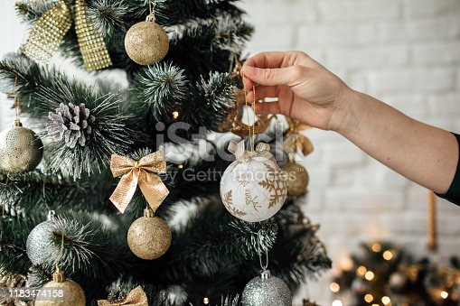 Christmas tree decoration on a white brick background. Christmas and new year concept. Christmas decor.