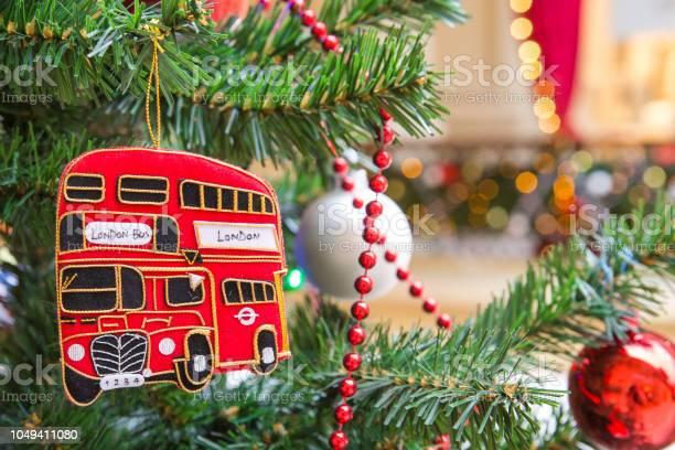 Christmas tree decoration with red doubledecker london bus picture id1049411080?b=1&k=6&m=1049411080&s=612x612&h=szmidccwaj818cuywfdi  c wcak7ugnnoqw4hha2zk=
