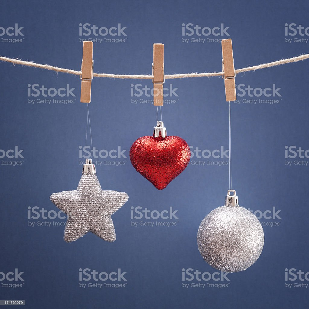 Christmas tree decorations hanging from clothesline royalty-free stock photo