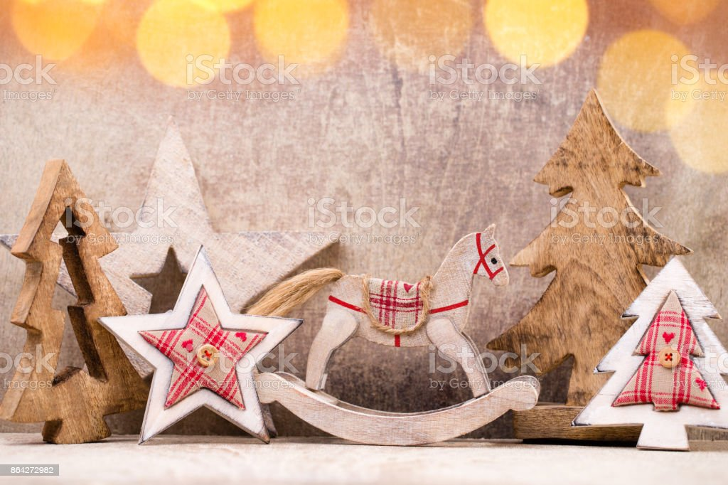 Christmas tree decorations on a wooden background. With bokeh ornaments. royalty-free stock photo