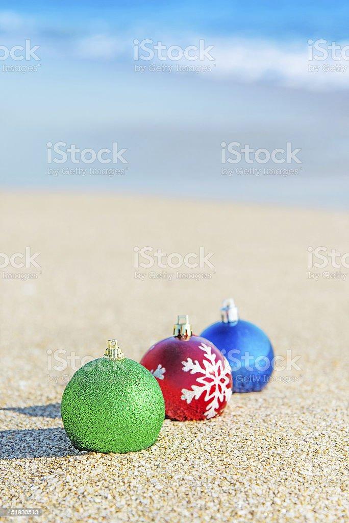 Christmas tree decorations on sea coast stock photo