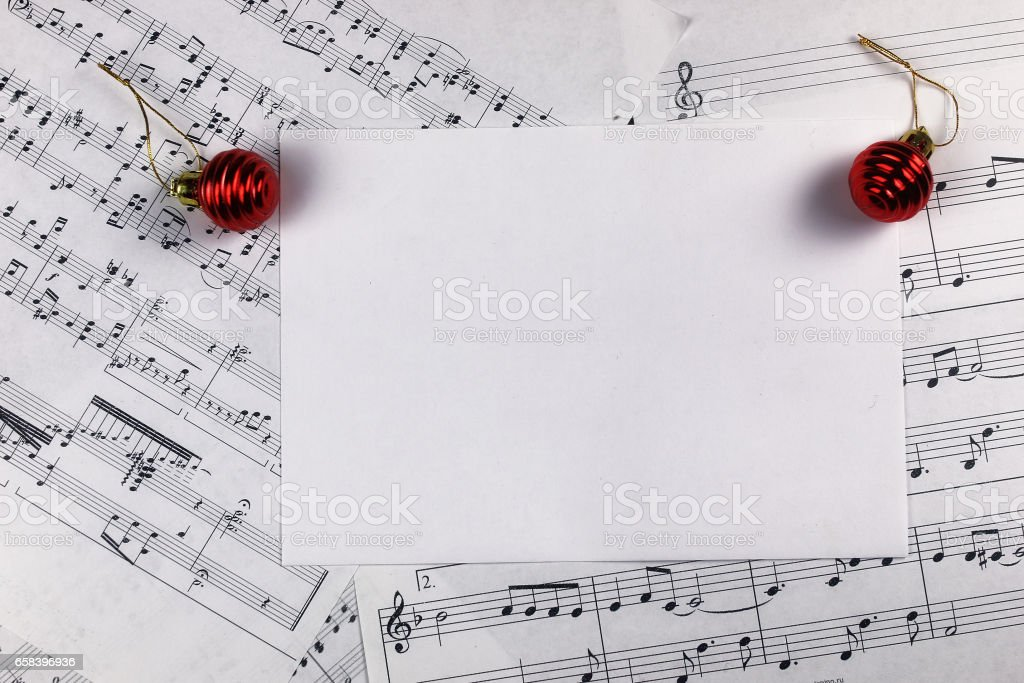 Christmas tree decorations on the table and sheet with music not stock photo