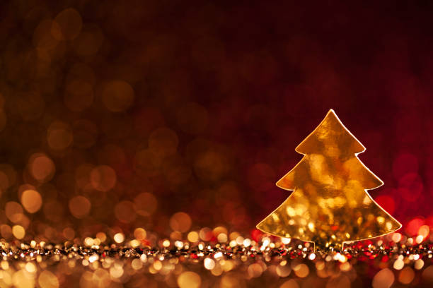 Christmas Tree - Defocused Decoration Gold Red Bokeh Backdrop Background stock photo