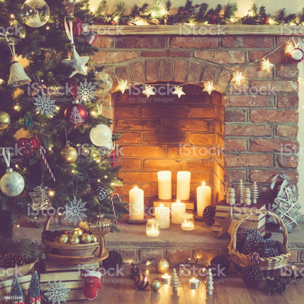 Christmas Tree Fireplace Candles In The Room Stock Photo