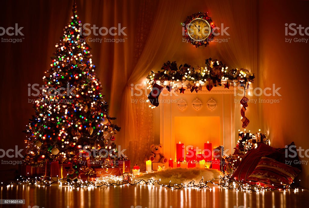 Christmas Tree Fireplace Lights, Decorated Xmas Living Room, Night Interior stock photo