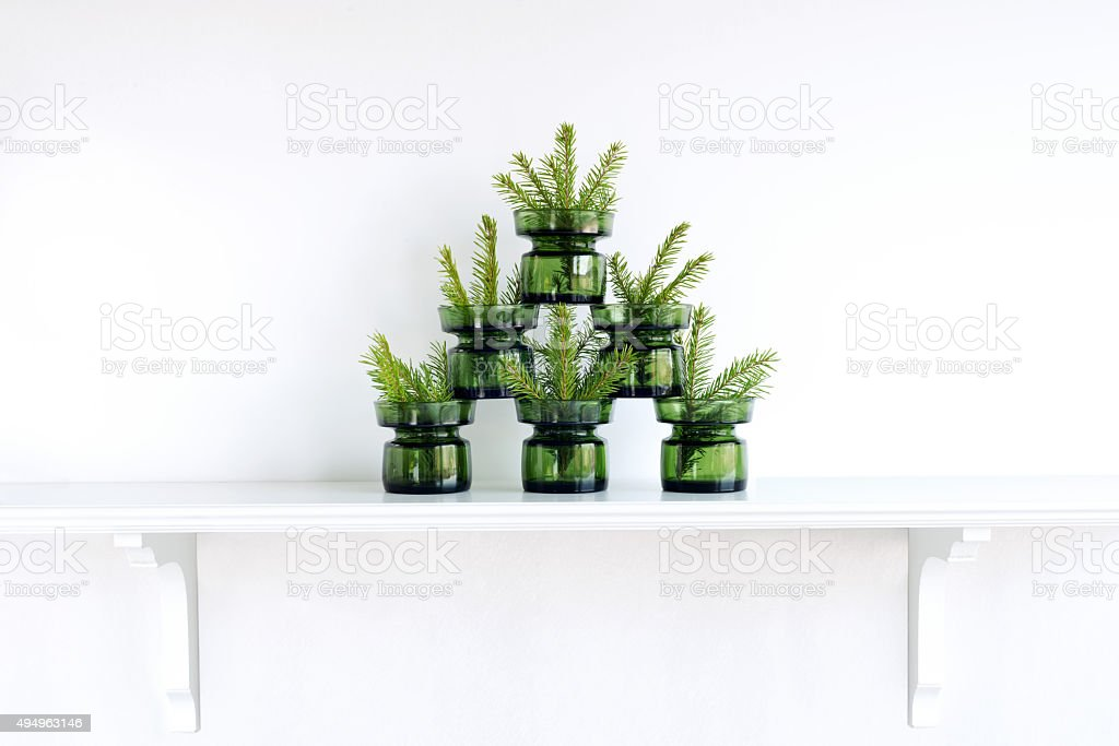 Christmas tree formed by green glasses stock photo