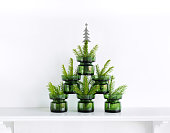 istock Christmas tree formed by green glasses 494963152