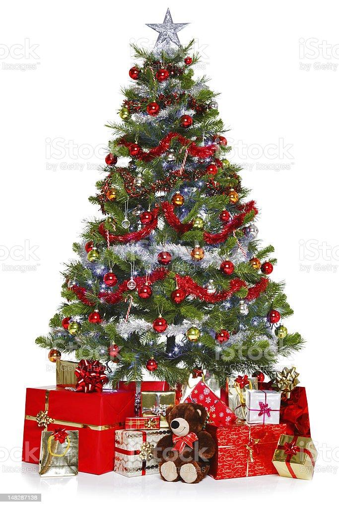 Christmas tree full of presents stock photo