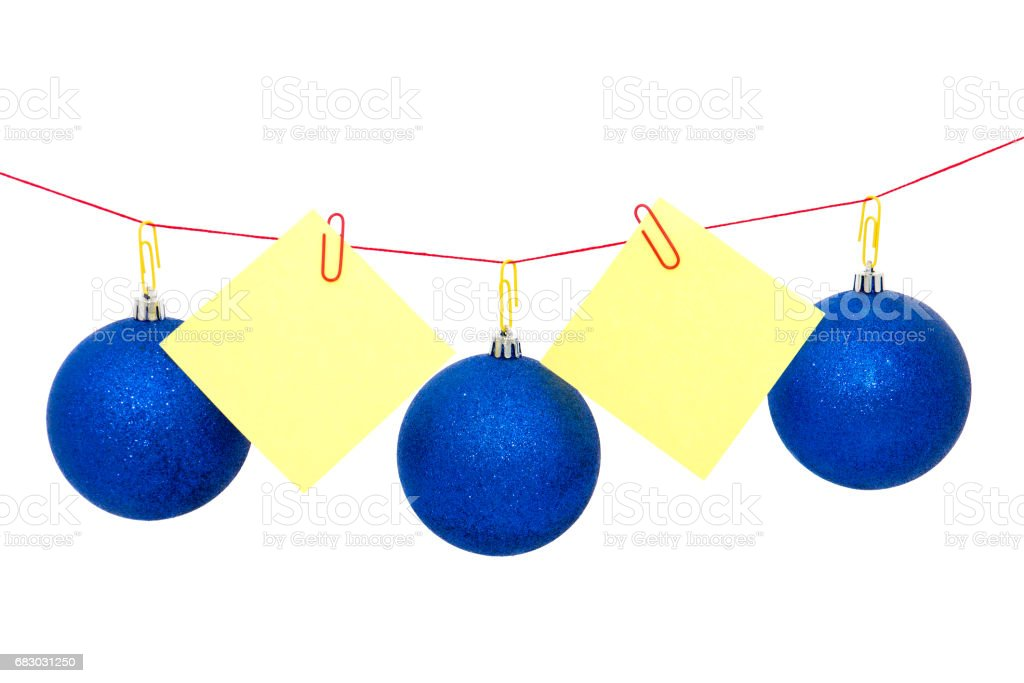 Christmas tree garland with notes, New Year`s or Christmas balls. stock photo
