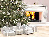 Christmas tree, gift and stocking near fireplace